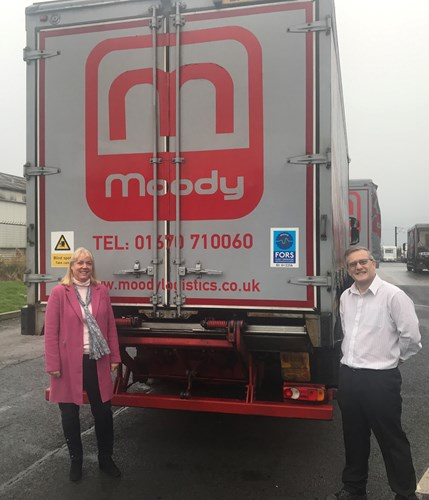 Caroline Moody and Paul Johnson display the FORS logo on one of the company's trucks